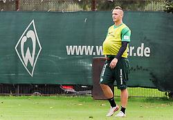19.08.2011, Trainingsgelaende, Bremen, GER, 1.FBL, Training Werder Bremen, im Bild Marko Arnautovic (Bremen #7) hat sich einen Ball unter das Trikot gesteckt..// during training session from Werder Bremen on 2011/08/19, Trainingsgelaende, Bremen, Germany..EXPA Pictures © 2011, PhotoCredit: EXPA/ nph/  Frisch       ****** out of GER / CRO  / BEL ******