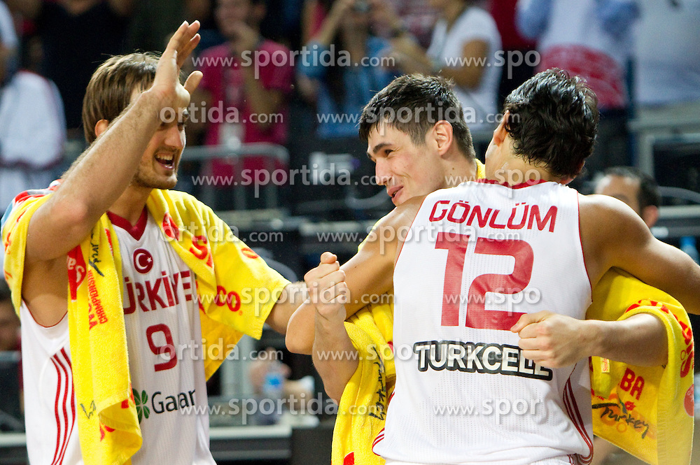 Semih Erden of Turkey, Ersan Ilyasova of Turkey and Kerem Gonlum of Turkey celebrate after the quarter-final basketball match between National teams of Turkey and Slovenia at 2010 FIBA World Championships on September 8, 2010 at the Sinan Erdem Dome in Istanbul, Turkey.  Turkey defeated Slovenia 95 - 68. (Photo By Vid Ponikvar / Sportida.com)