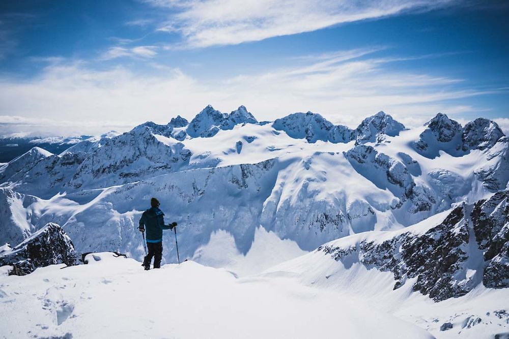 Simon Thomson takes in the view from Loft Peak, Howson Range, British Columbia.