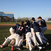 McMahon Senators players celebrate victory in an extra inning 3-2 win during the High School Baseball ball game between Trumbull Golden Eagles and McMahon Senators at Brien McMahon High School. Norwalk, Connecticut. USA. 26th April 2012. Photo Tim Clayton