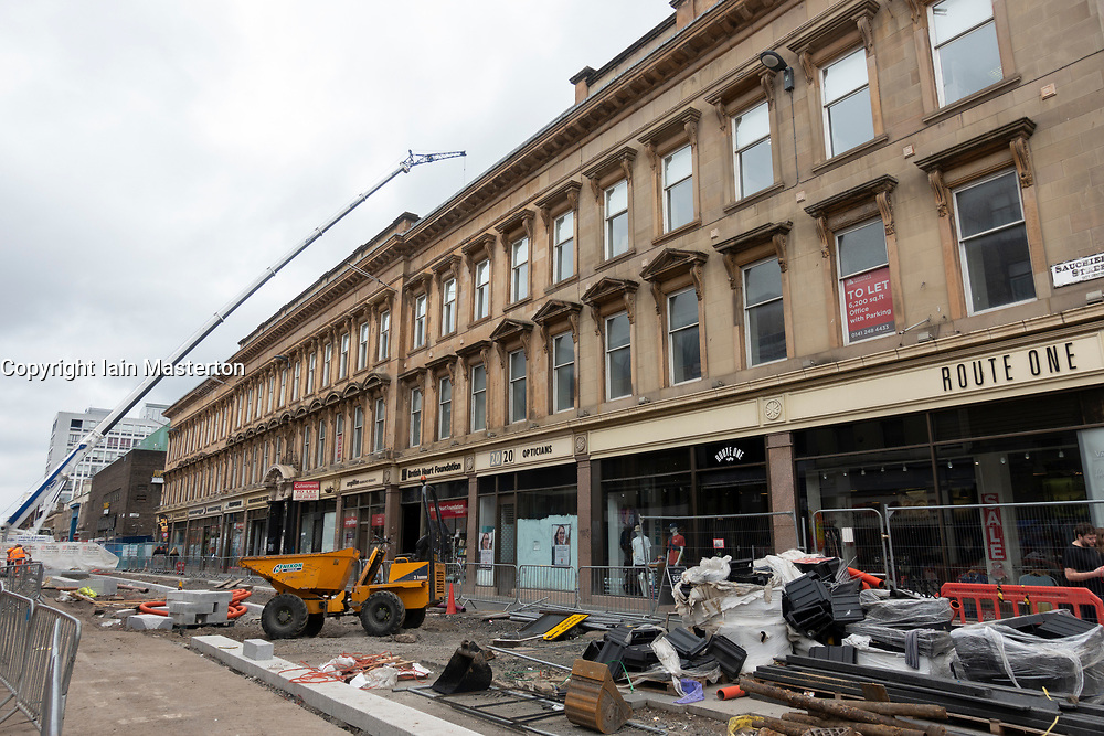 View of temporary footpath on Sauchiehall Street after closure following fire at Glasgow School of Art, Glasgow,Scotland, UK