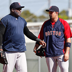 February 19, 2011; Fort Myers, FL, USA; Boston Red Sox first baseman David Ortiz (34) and first baseman Adrian Gonzalez (28) talk during spring training at the Player Development Complex.  Mandatory Credit: Derick E. Hingle