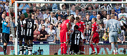 NEWCASTLE-UPON-TYNE, ENGLAND - Sunday, April 1, 2012: Liverpool's Martin Skrtel, Jamie Carragher, John Flanagan and Jay Spearing talk with Newcastle United's James Perch, as referee Martin Atkinson decides to send off Liverpool's goalkeeper Jose Reina, during the Premiership match at St James' Park. (Pic by Vegard Grott/Propaganda)