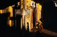 Late afternoon shadows on a street corner in Hoi An, Vietnam