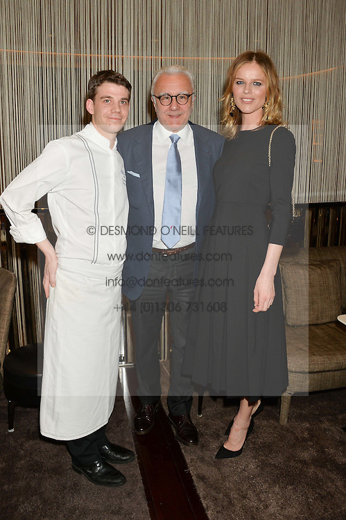 Left to right, DAMIEN LEROUX, ALAIN DUCASSE and EVA HERZIGOVA at the Launch Of Alain Ducasse's Rivea Restaurant At The Bulgari Hotel, 171 Knightsbridge, London on 8th May 2014.
