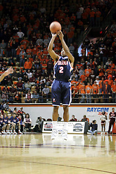 J. R. Reynolds (2) with a three point shot against Virginia Tech.  Reynolds had 16 points on the game to help lead the Hoos to a 54-49 victory in Blacksburg.
