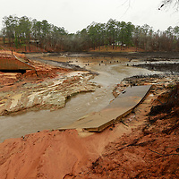 Thomas Wells   BUY AT PHOTOS.DJOURNAL.COM<br /> The boat ramp near the levee at Lake Whiteside lies at the bottom of what was the lake on Monday following a weekend collapse at the Nettleton Fox Hunting and Fishing Association.