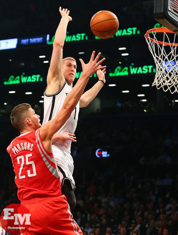 Apr 1, 2014; Brooklyn, NY, USA; Brooklyn Nets forward Mason Plumlee (1) blocks a shot by Houston Rockets forward Chandler Parsons (25) during the second quarter at Barclays Center.