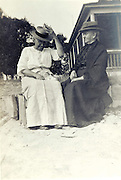 two happy elderly women sitting outside