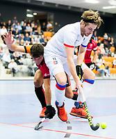 ROTTERDAM  - NK Zaalhockey,   halve finale heren Oranje Rood-SCHC (SCHC wint en plaatst zich voor de finale)  Bram  Weers (SCHC)  met Benjamin Stanzl (Oranje-Rood)  COPYRIGHT KOEN SUYK