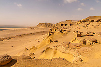 Beautiful rocky ridges and yellow sand in the desert beyond the Fayum oasis, Egypt.