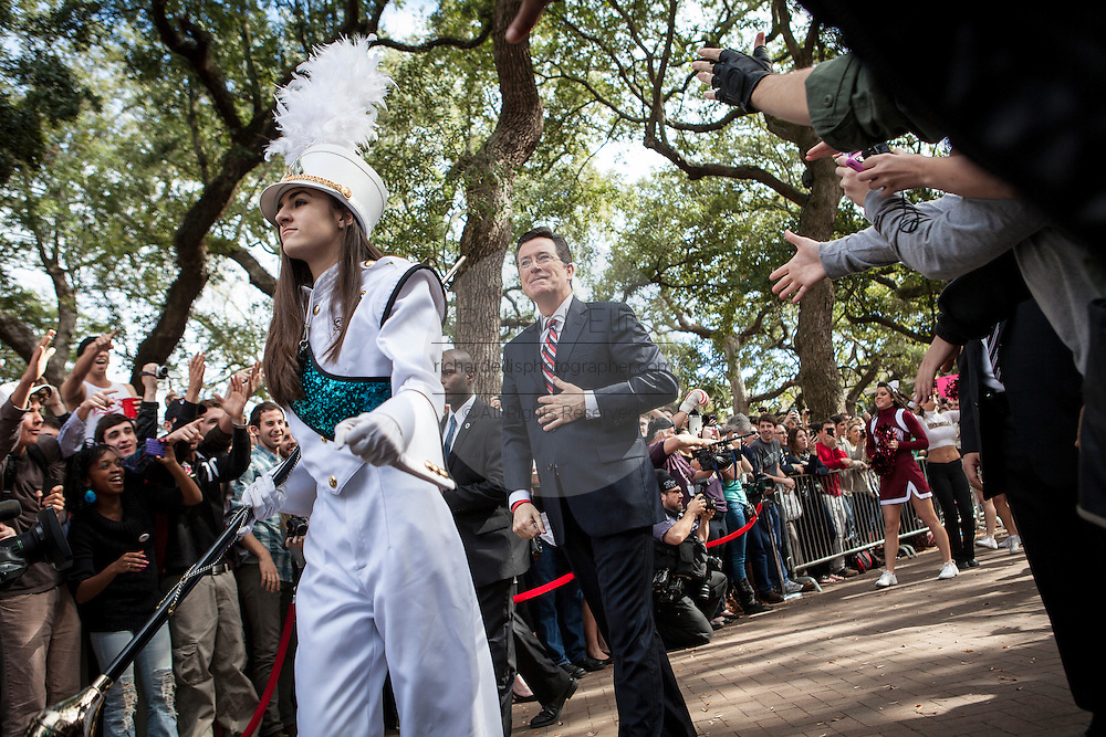 Comedian Stephen Colbert marches into a rally with former Republican presidential candidate Herman Cain at the College of Charleston on January 20, 2012 in Charleston, South Carolina. Colbert held the event with Cain, titled Rock Me Like a Herman Cain South Cain-olina Primary Rally, as part of his pseudo-run for president of The United States of South Carolina.
