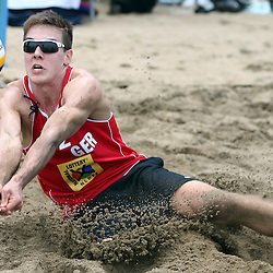 DURBAN, SOUTH AFRICA - DECEMBER 11: David Poniewaz of GER in action during the FIVB Durban Open at New Beach on December 11, 2013 in Durban, South Africa.  (Photo by Steve Haag/Getty Images for FIVB)