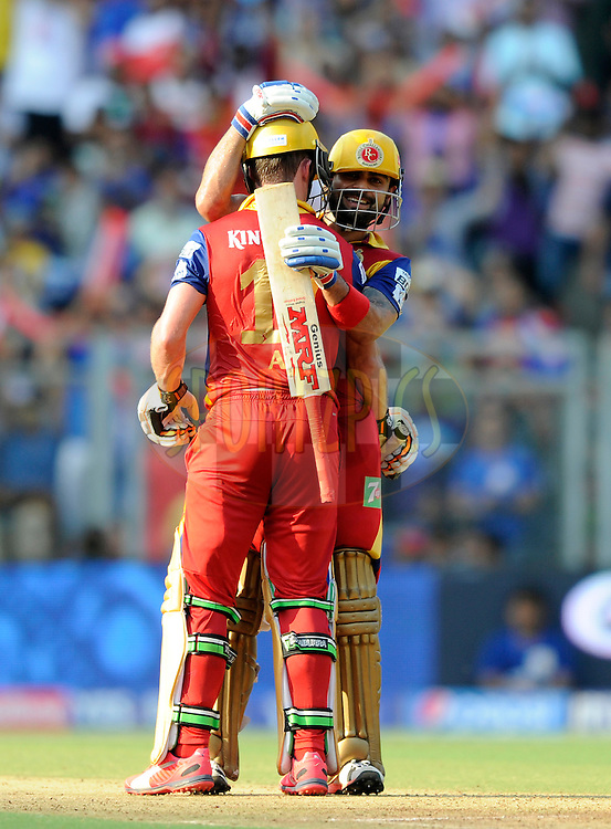 AB De Villiers of Royal Challengers Bangalore is congratulated by teammate Virat Kohli captain of Royal Challengers Bangalore as the earlier scores a century during match 46 of the Pepsi IPL 2015 (Indian Premier League) between The Mumbai Indians and The Royal Challengers Bangalore held at the Wankhede Stadium in Mumbai, India on the 10th May 2015.<br /> <br /> Photo by:  Pal Pillai / SPORTZPICS / IPL