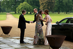 The Duke and Duchess of Cambridge are greeted by the Marquess and Marchioness of Cholmondeley (at left) as they attend a gala dinner at Houghton Hall in King's Lynn in support of East Anglia's Children's Hospices' nook appeal, which is raising funds to build and equip a new children's hospice for families in Norfolk.