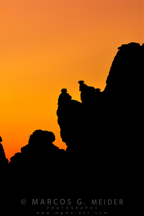 EN. Silhouetted rocks against a colourful sky at dusk.  Torcal de Antequera, Malaga province, Andalucia, Spain.<br /> ES. Rocas en silueta contra un colorido cielo al atardecer. Torcal de Antequera, Malaga, Andaluc&iacute;a, Espa&ntilde;a.