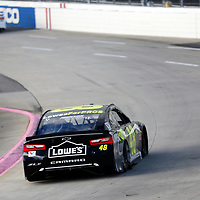 Jimmie Johnson (48) races through turn three to practice  for the First Data 500 at Martinsville Speedway in Martinsville, Virginia.