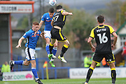 Jim McNulty wins a header under pressure from Richie Towell during the EFL Sky Bet League 1 match between Rochdale and Rotherham United at Spotland, Rochdale, England on 7 October 2017. Photo by Daniel Youngs.