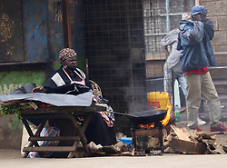 May 11, 2020, Nairobi, Kenya: A woman sells fried fish in Eastleigh during the protest..Eastleigh Residents took to the street to protest restriction of movement in the area due to the widespread case of Covid-19 within the residential area and appealed to the government to provide them with relief food. Kenya has confirmed 672 cases of Covid-19 and 32 deaths. (Credit Image: © Billy Mutai/SOPA Images via ZUMA Wire)