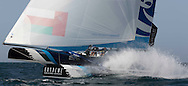 The Extreme Sailing Series 2013. Act 1. <br /> <br /> Showing The Wave Muscat, skippered by Leigh McMillan (GBR) with tactician Ed Smyth (NZL), mainsail trim Pete Greenhalgh (GBR), headsail trim Musab Al Hadi (OMA) and bowman Hashim Al Rashdi (OMA) <br /> <br /> Muscat. Oman<br /> Please credit: Lloyd Images