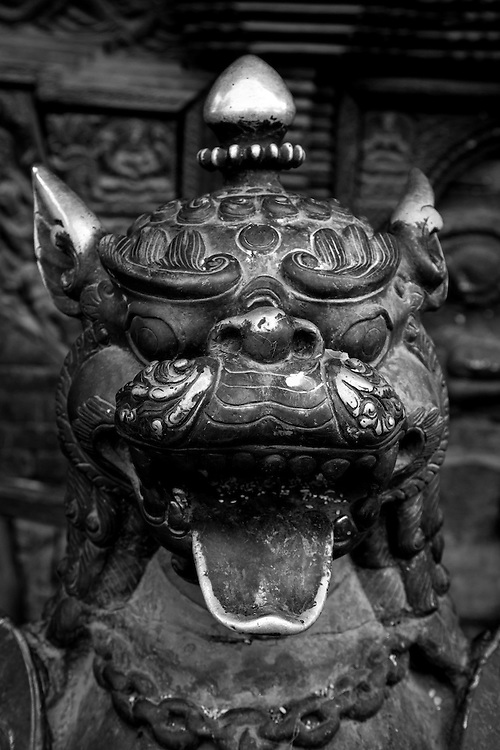 Statue at the door to a temple in Bhaktapur, Nepal