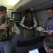 Journalists are fitted for body armor prior to the arrival of Air Force One in Baghdad, Iraq, Thursday, November 27, 2003.  In a clandestine night time move President Bush, with the knowledge of only a handful of senior staff, departed his ranch in Crawford, Texas and flew through the night to spend the Thanksgiving Day holiday visiting troops stationed in the war torn country...Photo by Khue Bui