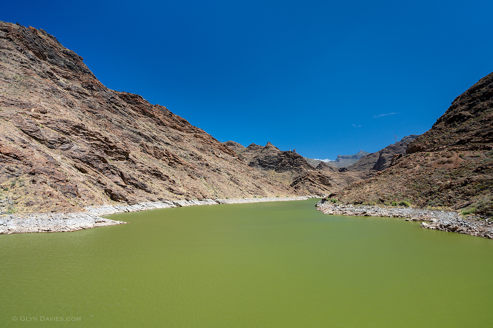 No idea why the reservoirs were so green up here in the mountains, but they certainly created an incredible compliment to the clear blue skies and hot arid earth.