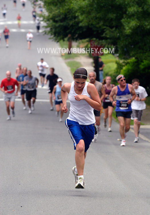 Middletown, N.Y. - Runners race along a suburban street during the Ruthie Dino-Marshall 5K Run on June 3, 2007.