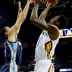 Dec 13, 2013; New Orleans, LA, USA; New Orleans Pelicans small forward Al-Farouq Aminu (0) shoots over Memphis Grizzlies small forward Tayshaun Prince (21) during the first quarter of a game at New Orleans Arena. Mandatory Credit: Derick E. Hingle-USA TODAY Sports