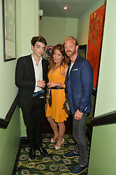 Left to right, SASCHA BAILEY, MIMI NISHIKAWA and ALISTAIR GUY at a Bastille Day Cocktail Party at L'Escargot, 48 Greek Street, London on 14th July 2014.
