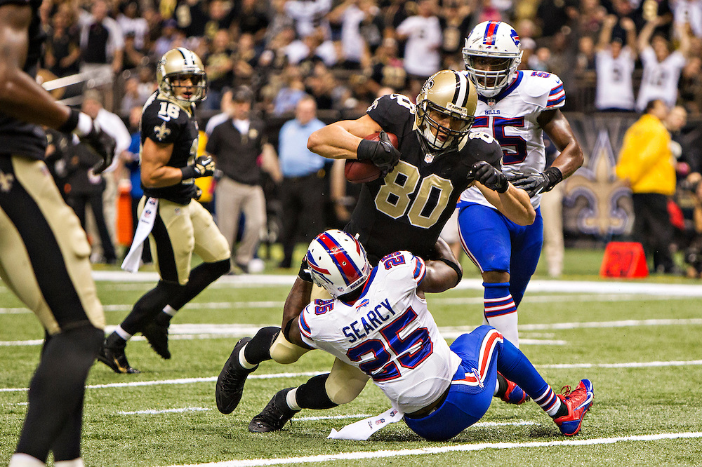 NEW ORLEANS, LA - OCTOBER 27:  Jimmy Graham #80 of the New Orleans Saints runs over Da'Norris Searcy #25 the Buffalo Bills on his way to the end zone at Mercedes-Benz Superdome on October 27, 2013 in New Orleans, Louisiana.  The Saints defeated the Bills 35-14.  (Photo by Wesley Hitt/Getty Images) *** Local Caption *** Jimmy Graham; Da'Norris Searcy