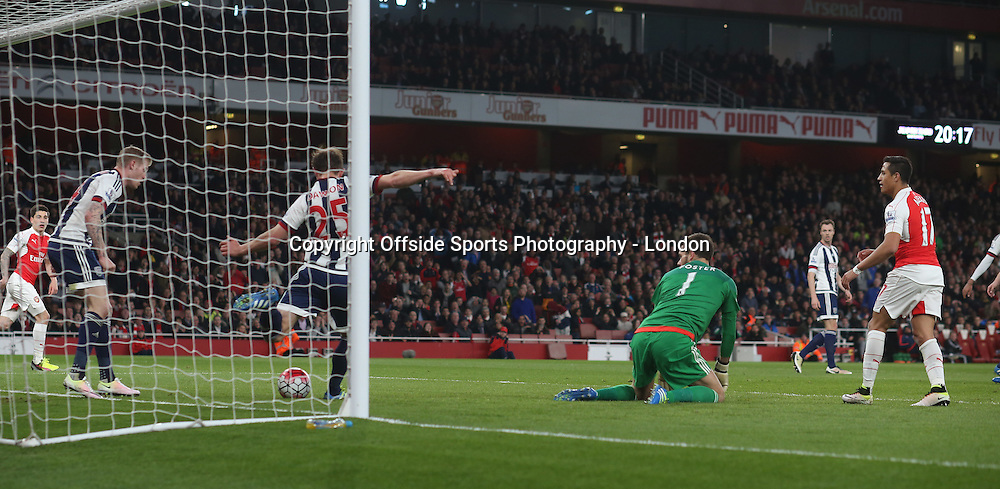 21 April 2016  Premier League Football - Arsenal v West Bromwich Albion :<br /> Craig Dawson spares the blushes of West Brom goalkeeper Ben Foster after the ball had rolled through his legs.<br /> Photo: Mark Leech