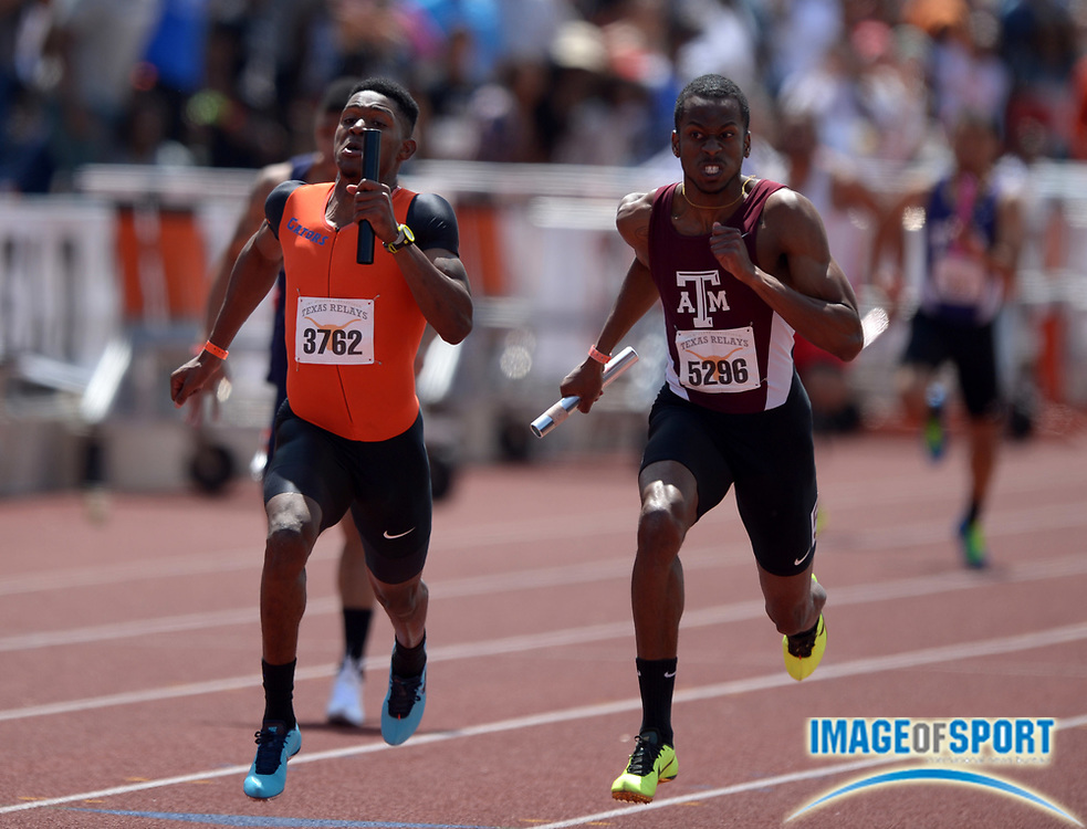 Mar 29, 2014; Austin, TX, USA; Dedric Dukes of Florida (left) outleans Deon Lendore of Texas A&M, 38.29 to 38.30, in the 87th Clyde Littlefield Texas Relays at Mike A. Myers Stadium.