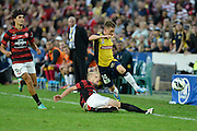 21.04.2013 Sydney, Australia. Wanderers midfielder Aaron Mooy tackles Mariners midfielder Michael McGlinchey in action during the Hyundai A League grand final game between Western Sydney Wanderers FC and Central Coast Mariners FC from the Allianz Stadium.Central Coast Mariners won 2-0.