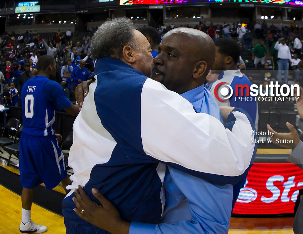 "Hampton University President Dr. William R. Harvey hugs head coach Edward ""Buck"" Joyner after their men's quarterfinal game versus Savannah State in the 2012 MEAC Basketball Tournament held at the Lawrence Joel Memorial Coliseum in Winston-Salem, North Carolina.  Hampton won 59 - 46.  March 07, 2012  (Photo by Mark W. Sutton)"