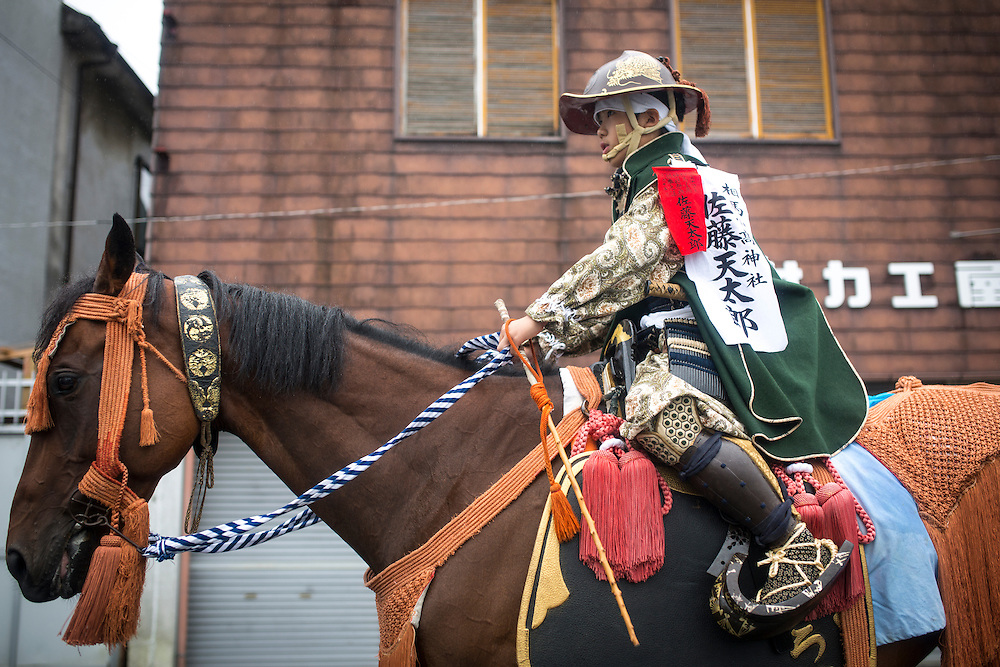 """MINAMISOMA, JAPAN - JULY 24 :  A young samurai horseman is seen during a """"Hon Matsuri"""" parade at the Soma Nomaoi festival at Minamisoma city on Sunday, July 24, 2016 in Fukushima Prefecture, Japan. """"Soma-Nomaoi"""" is a three day traditional festival that recreates a samurai battle scene from more than 1,000 years ago. The festival has gathered more than thousands visitors as Fukushima still continues to recovery from the 2011 nuclear disaster, the samurai warriors battles for recovery of the area. (Photo: Richard Atrero de Guzman/NURPhoto)"""