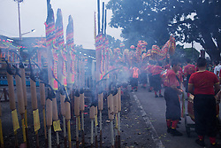 © Licensed to London News Pictures. 28/09/2014. Ipoh, Malaysia. Giants joss sticks burn at the Tong Tien Koon Temple as devotees prepare to process with deities through the street of central Ipoh, Malaysia on the 5th day of the Nine Emperor Gods Festival, Sunday, Sept. 28, 2014. The festival is a nine-day Taoist celebration to mark the birth of the Nine Emperor Gods from the first day to the ninth day of the ninth moon in Chinese Lunar Calender. The origin of the Nine Emperor Gods (stars of the Northern constellation) can be traced back to the Taoist worship of the Northern constellation during Qin and Han Dynasty and absorb this practice of worshipping the stars and began to deitify them as Gods. Photo credit : Sang Tan/LNP