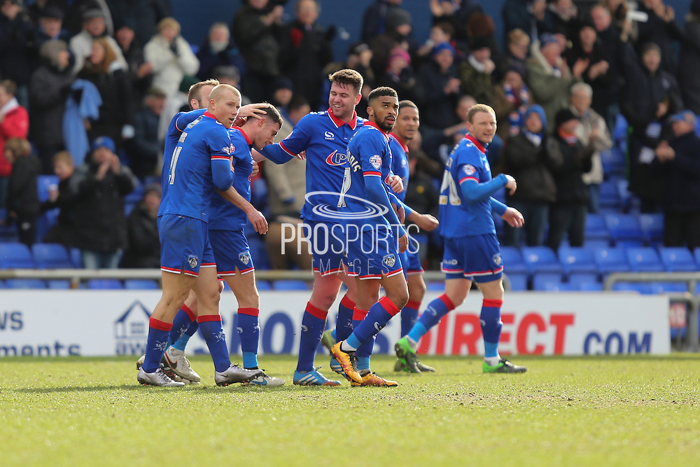 Mike Jones of Oldham Athletic celebrates scoring the first and only goal of the game with his Oldham team mates during the Sky Bet League 1 match between Oldham Athletic and Chesterfield at Boundary Park, Oldham, England on 28 March 2016. Photo by Simon Brady.