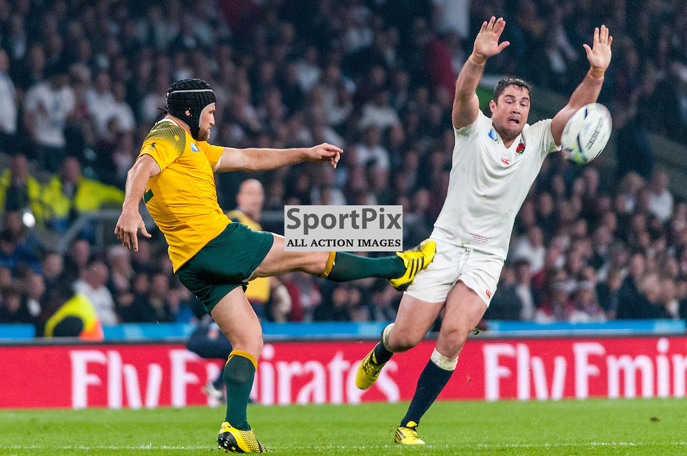 Matt Giteau of Australia kicks the ball down field. Action from the England v Australia game in Pool A of the 2015 Rugby World Cup at Twickenham in London, 3 October 2015. (c) Paul J Roberts / Sportpix.org.uk
