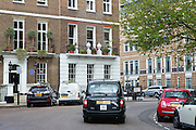 A taxi cab is passing by 14 Manchester Square (Dabaiba HQ) in central London, United Kingdom.<br /> <br /> CREDIT: Alex Masi for The Wall Street Journal<br /> CHESTERTON<br /> <br /> The name of London real-estate agency Chesterton Humberts exudes English affluence. But in early 2011, as Libya was engulfed in revolution, a substantial stake in the firm was quietly acquired by the wealthy family of a longtime lieutenant to Moammar Gadhafi, according to a person with direct knowledge of the investment.