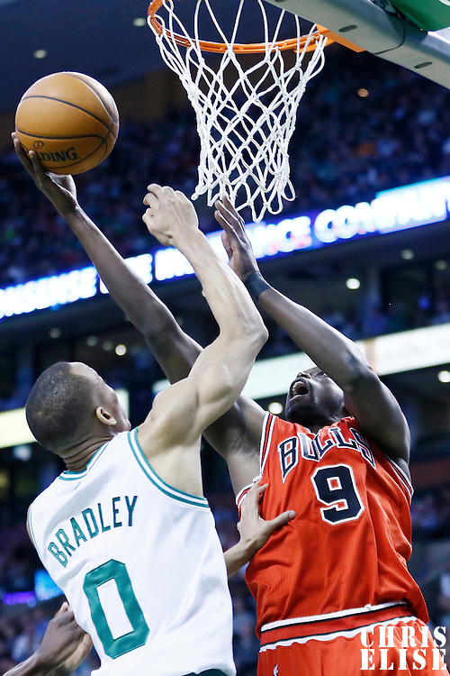 13 February 2013: Chicago Bulls small forward Luol Deng (9) goes for the layup over Boston Celtics point guard Avery Bradley (0) during the Boston Celtics 71-69 victory over the Chicago Bulls at the TD Garden, Boston, Massachusetts, USA.
