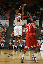 Adrian Joseph (30) watches as one of his three 3 point shots goes in against Hartford.  Joseph scored 15 points off the bench to help the Wahoos win 71-62...The Virginia Cavaliers defeated Hartford 71-62 at University Hall in Charlottesville, VA on December 31, 2005.