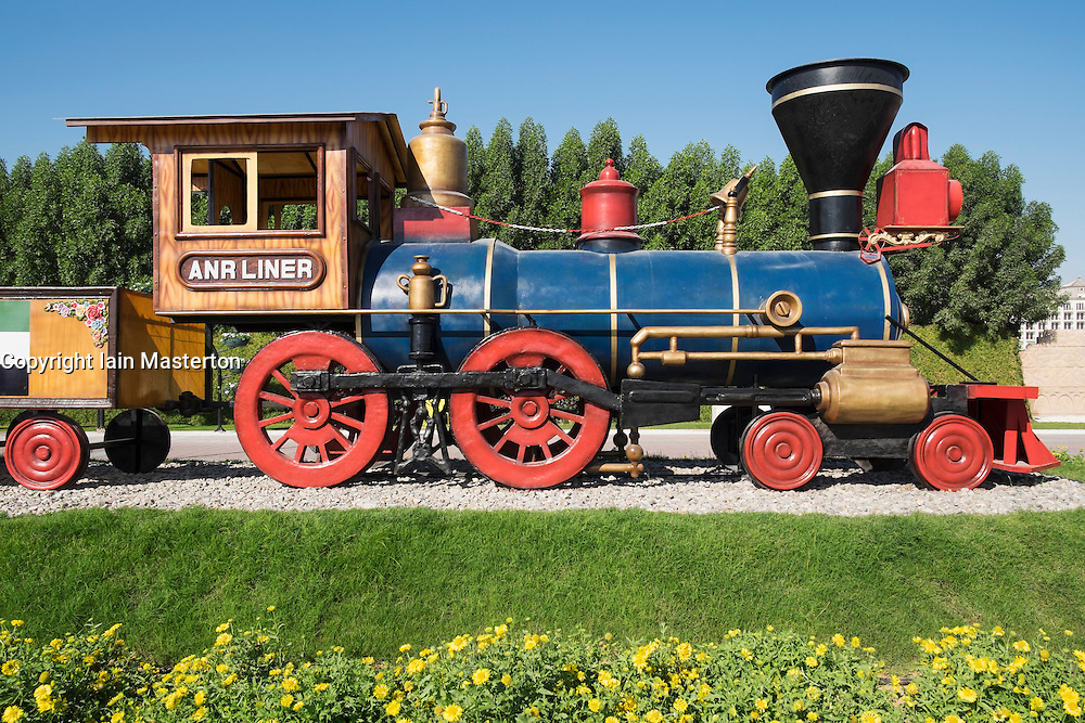 Steam train on display at  Miracle Garden the world's biggest flower garden in Dubai United Arab Emirates