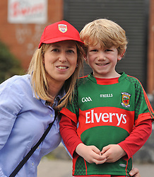 Mayo supporters Sharon and Callum Costello from Ballyvaryon their way to the Croke park for the All Ireland quarter final replay<br /> Pic Conor McKeown
