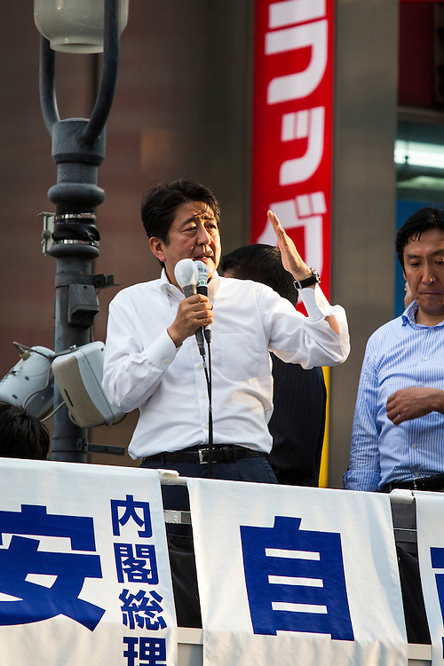 TOKYO, JAPAN - JULY 03 : Japanese Prime Minister Shinzo Abe, president of the ruling Liberal Democratic Party, greets the voters during the July 10 Upper House election campaign in Shibuya crossing, Tokyo prefecture, Japan, on July 3, 2016.  Photo: Richard Atrero de Guzman