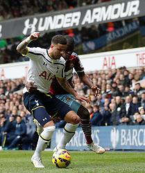 Tottenham Hotspur's Kyle Walker and West Ham's Diafra Sakho compete for the ball - Photo mandatory by-line: Mitchell Gunn/JMP - Mobile: 07966 386802 - 22/02/2015 - SPORT - football - London - White Hart Lane - Tottenham Hotspur v West Ham United - Barclays Premier League