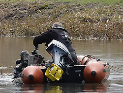 police divers remove material during a search of a section of the Monklands Canal at Carnbroe by Police Scotland's underwater search unit in the search for the remains of 11-year-old Moira Anderson, who disapeared in 1957 and is widely believed to have been abducted and murdered by convicted paedophile Alexander Gartshore. <br /> <br /> © Dave Johnston/ EEm