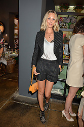 LISA HENREKSON at a party to celebrate the publication of 'Feeding The Future' by Lohralee Astor and Tali Shine held at OKA, 155-167 Fulham Road, London on 8th June 2016.