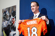 SHOT 3/20/12 2:17:28 PM - The Denver Broncos introduced free agent quarterback Peyton Manning at team headquarters in Englewood, Co. at a press conference on Tuesday Marc 20, 2012. Manning is coming off neck surgery and was released by the Indianapolis Colts. He signed a five year, $96 million contract with the Broncos..(Photo by Marc Piscotty / © 2012)