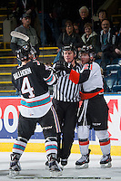 KELOWNA, CANADA - DECEMBER 4: Linesman Ward Pateman gets between Gordie Ballhorn #4 of Kelowna Rockets and Chad Butcher #21 of Medicine Hat Tigers on December 4, 2015 at Prospera Place in Kelowna, British Columbia, Canada.  (Photo by Marissa Baecker/Shoot the Breeze)  *** Local Caption *** Ward Pateman; Gordie Ballhorn; Chad Butcher;